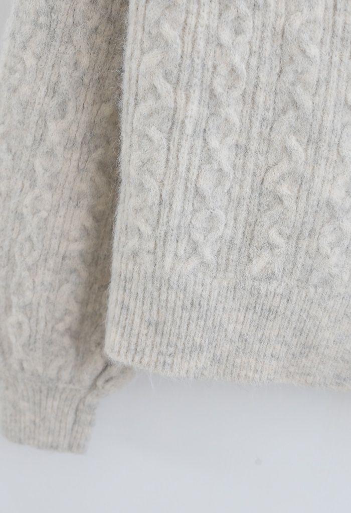 Geflochtene Strickjacke mit Zopfknopf aus Elfenbein