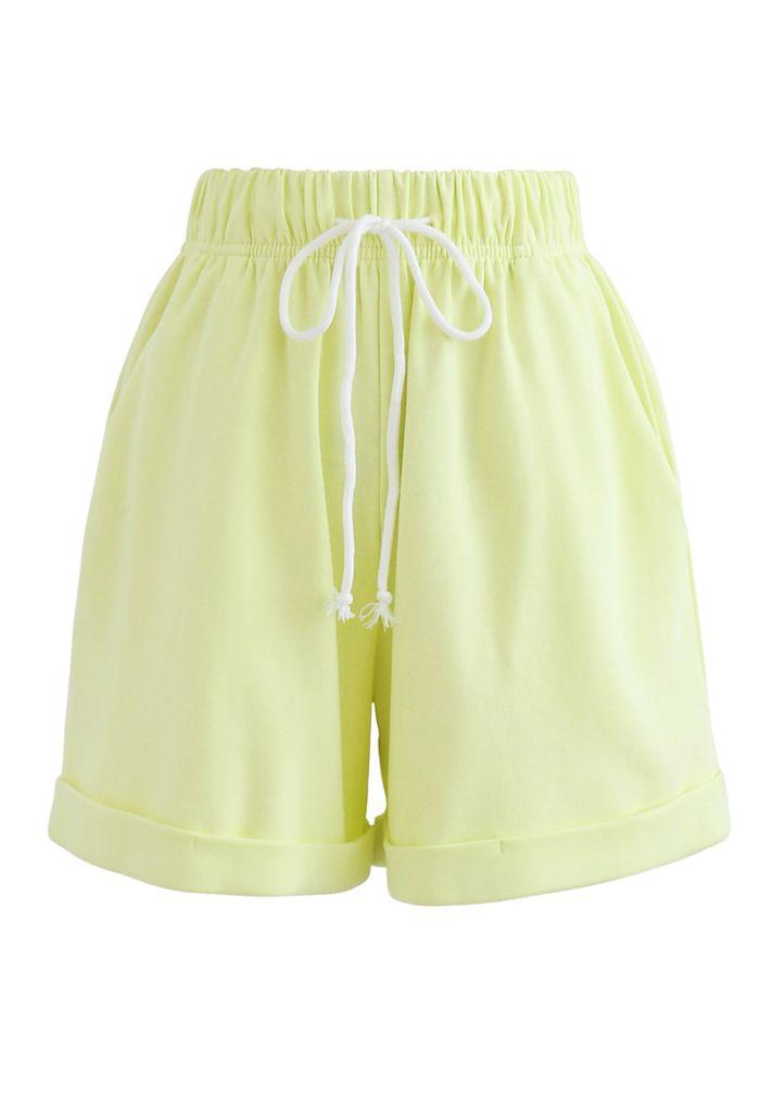 Gefaltete Saum Kordelzug Taschen Shorts in Limette