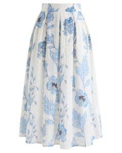Blauer, mit Blumen bedruckter, mit Ösen bestickter Midirock