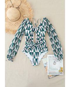 Ausschnitt-Neckholder-Badeanzug mit Netzärmeln im grünen Dreieck