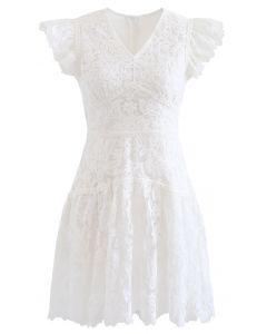 Gesticktes ärmelloses Minikleid mit Blumenmuster in Weiß