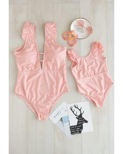 Solider Badeanzug mit rosa Rüschendetails für Mama und Kinder