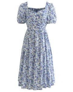 Geblümtes Baumwollkleid mit Kreuzausschnitt vorne hinten in Blau