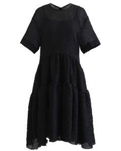 Glitzerndes, transparentes Dolly-Kleid mit Rüschen und Prägung in Schwarz