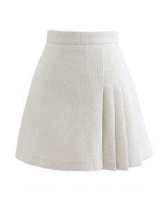 Schimmernder Tweed-Minirock mit Metallic-Plissee in Creme