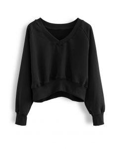 Oversize-Crop-Sweatshirt aus Baumwolle mit V-Ausschnitt in Schwarz