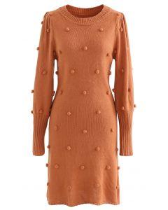 Pulloverkleid mit Puffärmeln und Pom-Pom in Orange