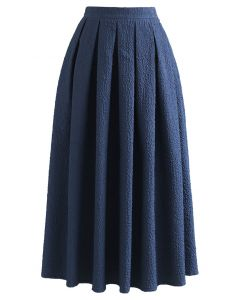 Carnation Embossed Satin Pleated Midi Skirt in Dark Blue