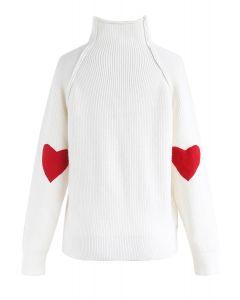 Herz und Seele: Strickpullover aus gebrochenem Weiß