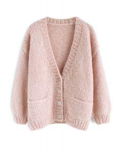 Entspannen Sie sich für die kuschelige rosa Strickjacke