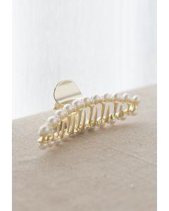 Große und kleine perlenbesetzte Haarklaue